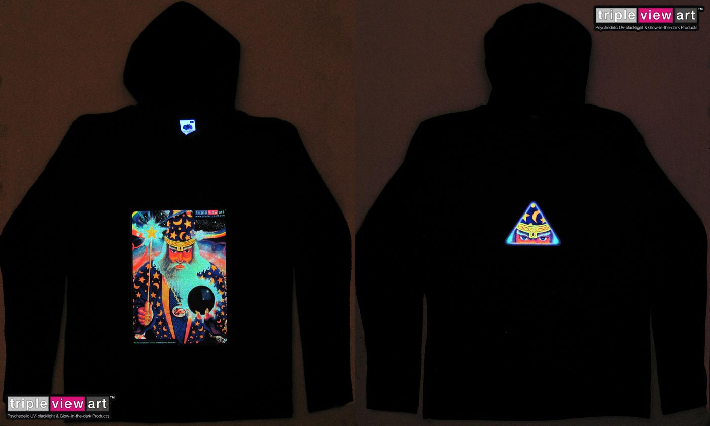 Merlin is a uv (ultraviolet) blacklight fluorescent and glow-in-the-dark phosphorescent afterglow short sleeve t-shirt and long sleeve hooded shirt print, made from the original psychedelic spiritual visionary fantasy fine art backdrop painting by symeon nostrakis of 333artworks/tripleviewart, and depicting the mystery of sorcery: wizard merlin wearing an amulet, holding a magic wand shooting rainbow colours and a magic sphere, standing on a field of amanita (fly agaric) mushrooms and under a starry night, a space filled with stars